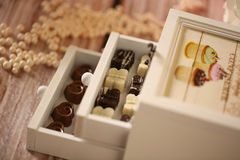Mini chocolate sweets in a wooden box Stock Photos