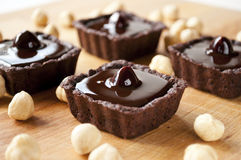 Mini chocolate tarts with nut Royalty Free Stock Image