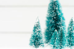Mini christmas artificial trees with shallow depth of field Stock Photo