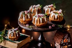 Mini Christmas Bundt Cakes. Decorated with Sugared Cranberries and Rosemary stock photo