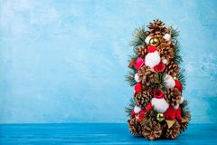Mini Christmas tree on blue background Royalty Free Stock Image