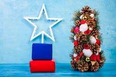 Mini Christmas tree on blue background Royalty Free Stock Photo