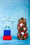 Mini Christmas tree on blue background Stock Image