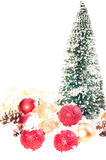 Mini Christmas tree with red, gold baubles on snow Royalty Free Stock Photo