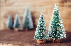 Mini christmas tree wood on rustic wooden table and dark brown h royalty free stock photos
