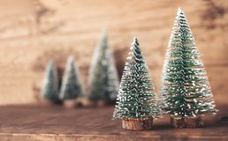 Mini christmas tree wood on rustic wooden table and dark brown h stock photos