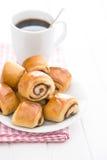 Mini cinnamon buns and coffee. Royalty Free Stock Photography