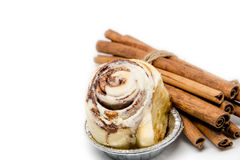 Mini cinnamon roll with cinnamon stick roped isolated Stock Photos