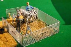 Mini circus statue: animal feeding Stock Photos