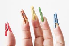 Mini clavijas en los fingeres Imágenes de archivo libres de regalías