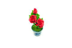 Mini clay rose flower in the pot Stock Photography