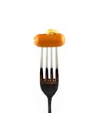 Mini cocktail sausages on fork with mustard Royalty Free Stock Images
