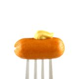 Mini cocktail sausages on fork with mustard Royalty Free Stock Image