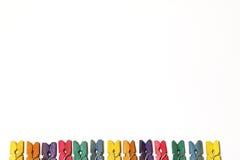 Mini Colourful Clothes Pegs Royaltyfri Bild