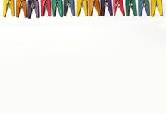 Mini Colourful Clothes Pegs Arkivbild