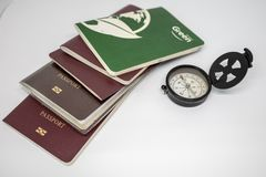 Mini Compass and lot of passport royalty free stock photos