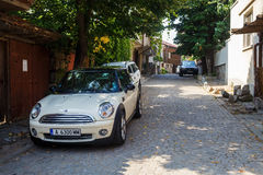 Mini Cooper car. Nesebar, Bulgaria - September 03, 2014: Mini Cooper car is parked on the narrow cobbled street of the old town of Nessebar, Bulgaria Royalty Free Stock Photography