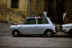 Old one Mini Cooper. A Classic Mini Cooper car parked in the street in Barcelona near Tibidabo Royalty Free Stock Images