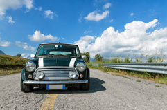 Mini Cooper front view. A British Green classic Mini Cooper parked on a road Royalty Free Stock Photos