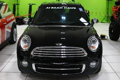 Mini Cooper. Mini introduced an all-new second generation of the Hardtop/Hatch model in November 2006, on a re-engineered platform incorporating many stylistic Royalty Free Stock Image