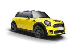 Mini Cooper novo amarelo isolado no branco foto de stock royalty free
