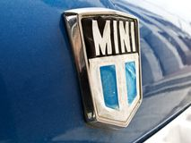 Mini cooper old logo. In the hood of a car Stock Photo