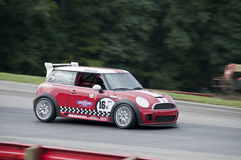 Mini Cooper race car. A Mini Cooper race car being driven at the 2011 NASA Championships at the Mid-Ohio Sports Car Course in Lexington, Ohio on September 10 Royalty Free Stock Images