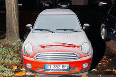 Mini Cooper red car covered with snow stock photos
