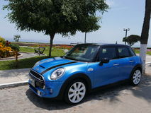 Mini Cooper S front and left side view in Lima, Peru. Lima, Peru. March 9, 2017. Front and left hand side view of a mint condition blue and black Mini Cooper S Royalty Free Stock Photography