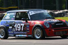 Mini Cooper S. Sarah Cattaneo races the Mini Cooper S for RSR Motorsports Mini USA at the pro motorsports racing event Royalty Free Stock Photos