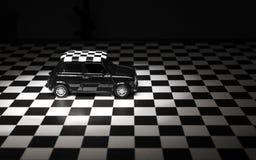 Mini cooper toy car studio shot. Izmir, Turkey - February 2, 2017. Black Mini Cooper toy car studio shot on a chequered background Stock Photo