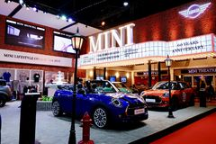 Mini cooper in trade show booth in motor show. royalty free stock image