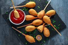 Mini Corn Dogs on stone platter with ketchup stock photos
