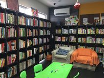 Mini and cozy library. Mini and cozy reading place, suitable for alone reading time. Equipped with small table, chairs and sofas Royalty Free Stock Photo