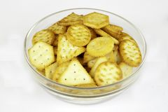 Mini crackers on bowl royalty free stock photo