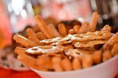 Mini crackers in white bowl Stock Photos