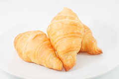 Mini croissant. 3 small croissant on white dish Royalty Free Stock Image