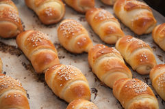 Mini croissants. With cheese and sesame Royalty Free Stock Image