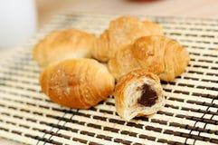 Mini croissants with chocolate Stock Photos