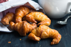 Mini croissants in a paper bag Stock Image
