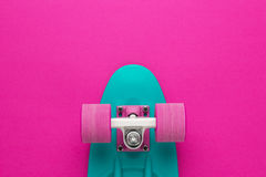 Mini cruiser board on deep pink back Stock Photos