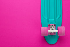 Mini cruiser board on deep pink back Royalty Free Stock Photography