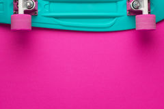 Mini cruiser board on deep pink back Royalty Free Stock Photo
