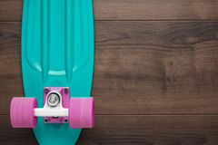 Mini cruiser board on wooden background Royalty Free Stock Image