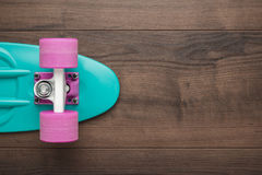 Mini cruiser board on wooden background Stock Images