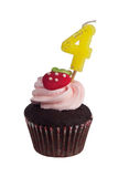 Mini cupcake with birthday candle for four year old Royalty Free Stock Images