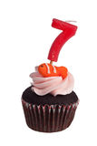 Mini cupcake with birthday candle for seven year old Stock Images