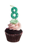 Mini cupcake with candle for eight year old Royalty Free Stock Photo
