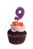 Mini cupcake with candle for nine year old Stock Images
