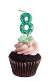 Mini cupcake met kaars voor acht éénjarigen Royalty-vrije Stock Foto